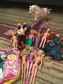 8 Barbies, 1 Ken and Barbie Horse with saddle - also bag of Barbie clothes and accessories