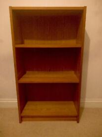 Freestanding three-shelf dark veneer bookcase - £10