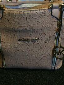 Michael kors light pink embossed floral bag