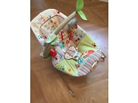 Vibrating baby bouncer with Toy bar that makes sounds