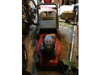 Self propelled petrol mower