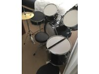 Drum kit for sale. New Hi hat & stand, & pads to muffel the sound in the house. Excellent buy !