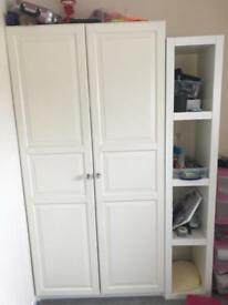 White wardrobe with shelve and double bed