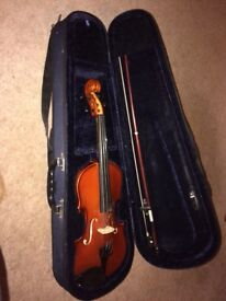 Child's violin and music stand