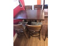 4 restaurant/takeaway chairs with 2 tables.....£50 ONO