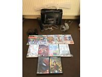 Black Nintendo Wii and 11 games