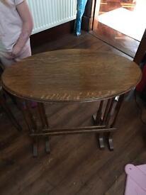 Pair of dark wood antique nesting tables