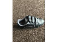 Black and grey Nike trainers