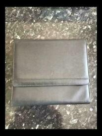 Car document wallet, may be for a Porsche?