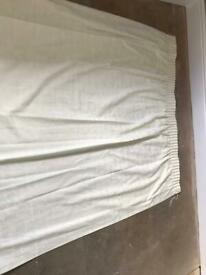 Pair of long cream curtains