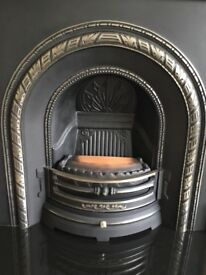 Cast iron fireplace with electric fire. Also suitable to convert to gas. Excellent condition