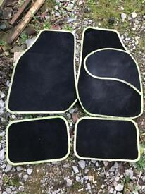 Black Halfords car mats with green stitching