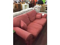 Large sofa - rust red colour. Plus matching feather cushions!