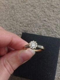 Gold solitaire diamond ring. Size P