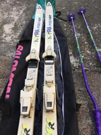 Pair of Fischer Skis with Poles and Salomon Carry Bag