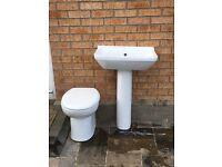 Closed toilet & bathroom sink