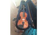 Primavera violin. Not sure size either a half or quarter.
