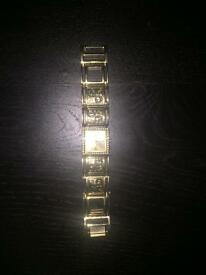 Ladies Gold Guess watch