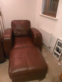 Leather arm chair and footstool