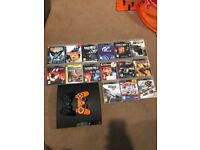 Ps3 slim 2 controllers and 15 games
