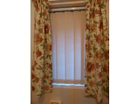 A pair of small pretty lined curtains
