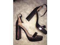 Woman's metallic heels