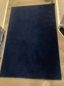 Dark blue rug