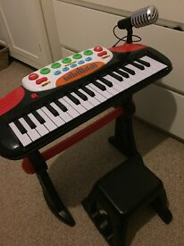 CHILDRENS KEYBOARD WITH SEAT SINGING MUSICAL