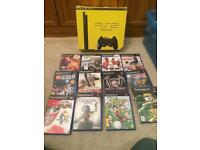 Boxed Sony slim ps2 console and games