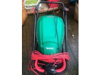Qualcast lawn mower full working order and good condition. Moving to a house with no grass!