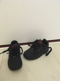 Infants size 7 black Adidas with red logo