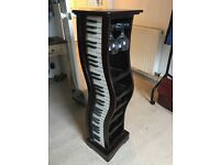 Solid wood 12 bottle piano wine rack.