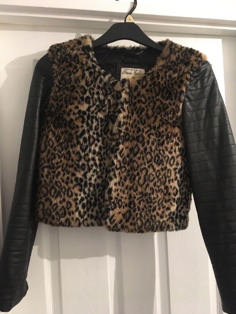 Leopard print fur and black leather coat
