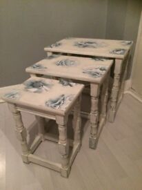 Wooden shabby chic style nest of three tables.