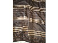 A pair of brown pencil pleat