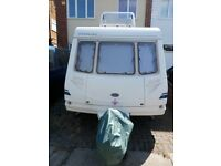 2001, 5 BERTH EUROPA 510 CARAVAN WITH AWNINGS AND LOTS OF EXTRAS