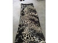 Leapard print long black skirt size m/L