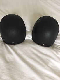 Horse riding body protector and 2 helmets in perfect condition.