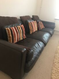 Large Low back brown leather sofa.