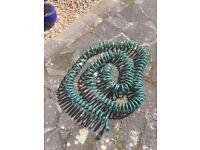 Long coil garden hose
