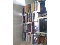A collection of 70 assorted paperback books.