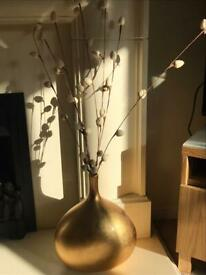 Gold vase with cream stems