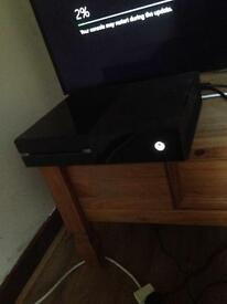 Black Xbox one console with one controller