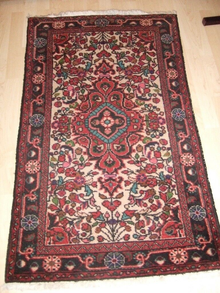 Two Hand Made Pure Wool Persian Rugs Size 125 x 74 and 75 x 51