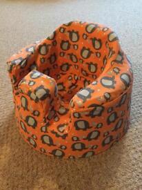 Bumbo Seat and Orange Elephant Cover