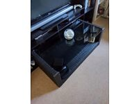 Black wicker style coffee table with glass top