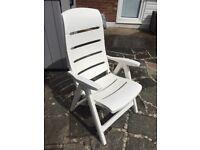 White plastic garden recliner chair