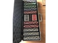 Poker chips in silver case with cards and dice