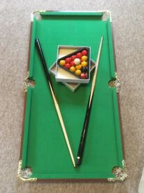 4ftx2ft snooker table. No rips. Two cues. All balls and triangle.