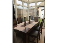 Dansk solid walnut table and 6 chairs